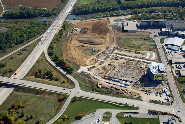 Looking E at the Iowa River Landing. New UIHC Clinic, parking ramp, and streets under construction. Coralville Marriott upper right.
