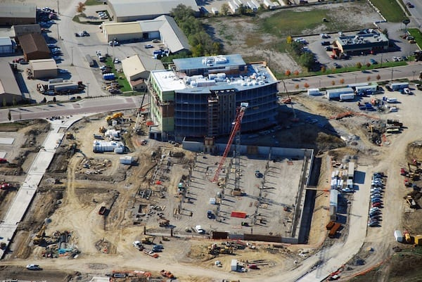 Looking SW at new UIHC Clinic, parking ramp, and streets under construction in the Iowa River Landing.