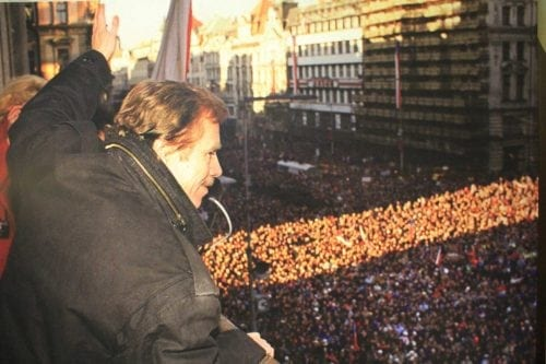 Havel waving over a crowd