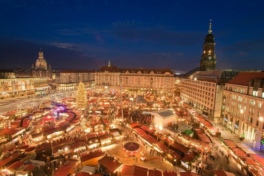 The town square of Dresden, Germany at night with the Christmas Market in the middle