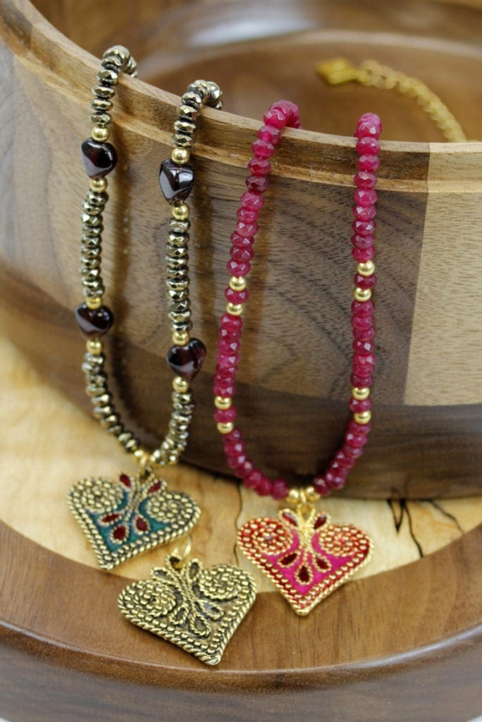Three necklaces on wooden decorative bowl