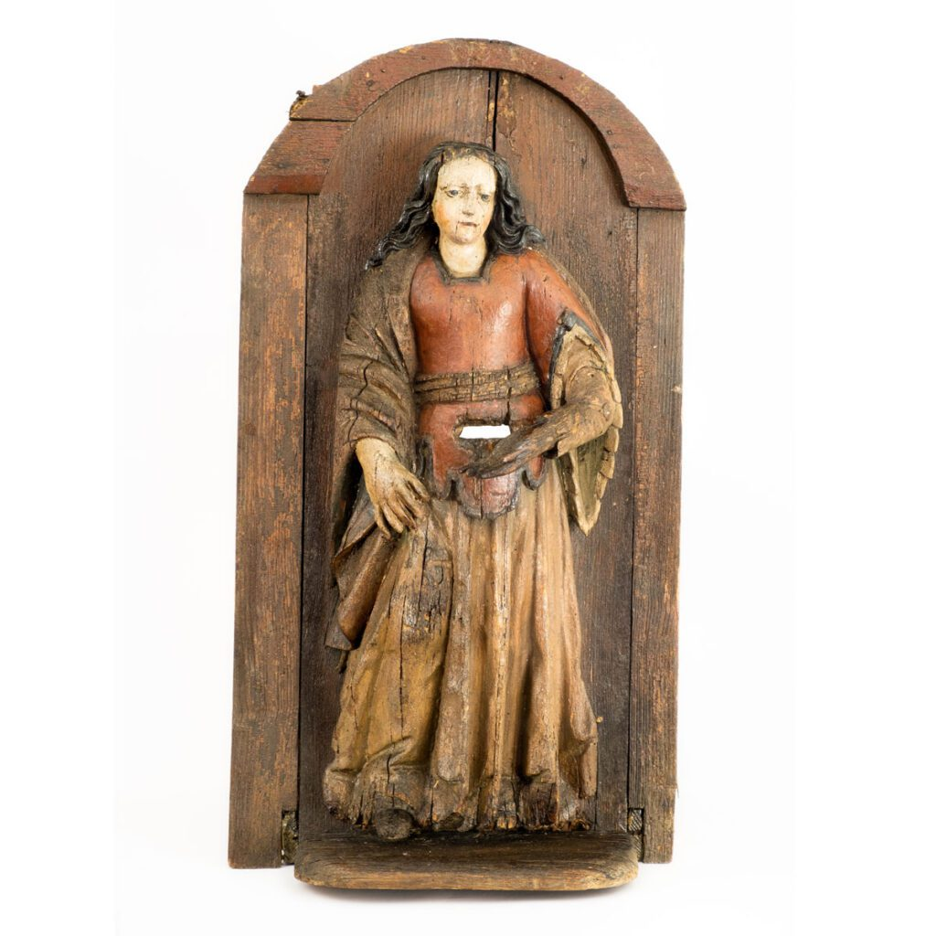 Wooden beehive with the sculpture of St. Margaret of Antioch